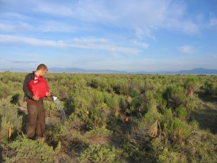 Andrew Carlson applies stored rainfall to experimental plots in the San Luis Valley, Colorado.