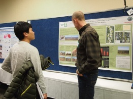 NREL graduate student Shinichi Asao asking questions of GDPE graduate student Garrett Stephens at the FRSES poster session.
