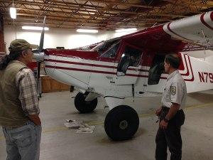 Paul Evangelista (left) and Mark Bertram prepare to fly over the Yukon Flats National Wildlife Refuge for preliminary elodea map validation. Credit: Matt Luizza.
